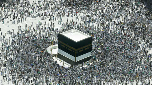 Muslim pilgrims circumambulate around the Kaaba, the cubic building at the Grand Mosque, in the Muslim holy city of Mecca, Saudi Arabia.