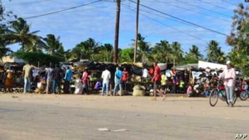 FILE - Residents visit a market in Macomia, northern Mozambique, June 11, 2018. Some experts believe IS set its sights on Mozambique, particularly its northern region because of the economic disparity which can drive radical Islamist ideology.