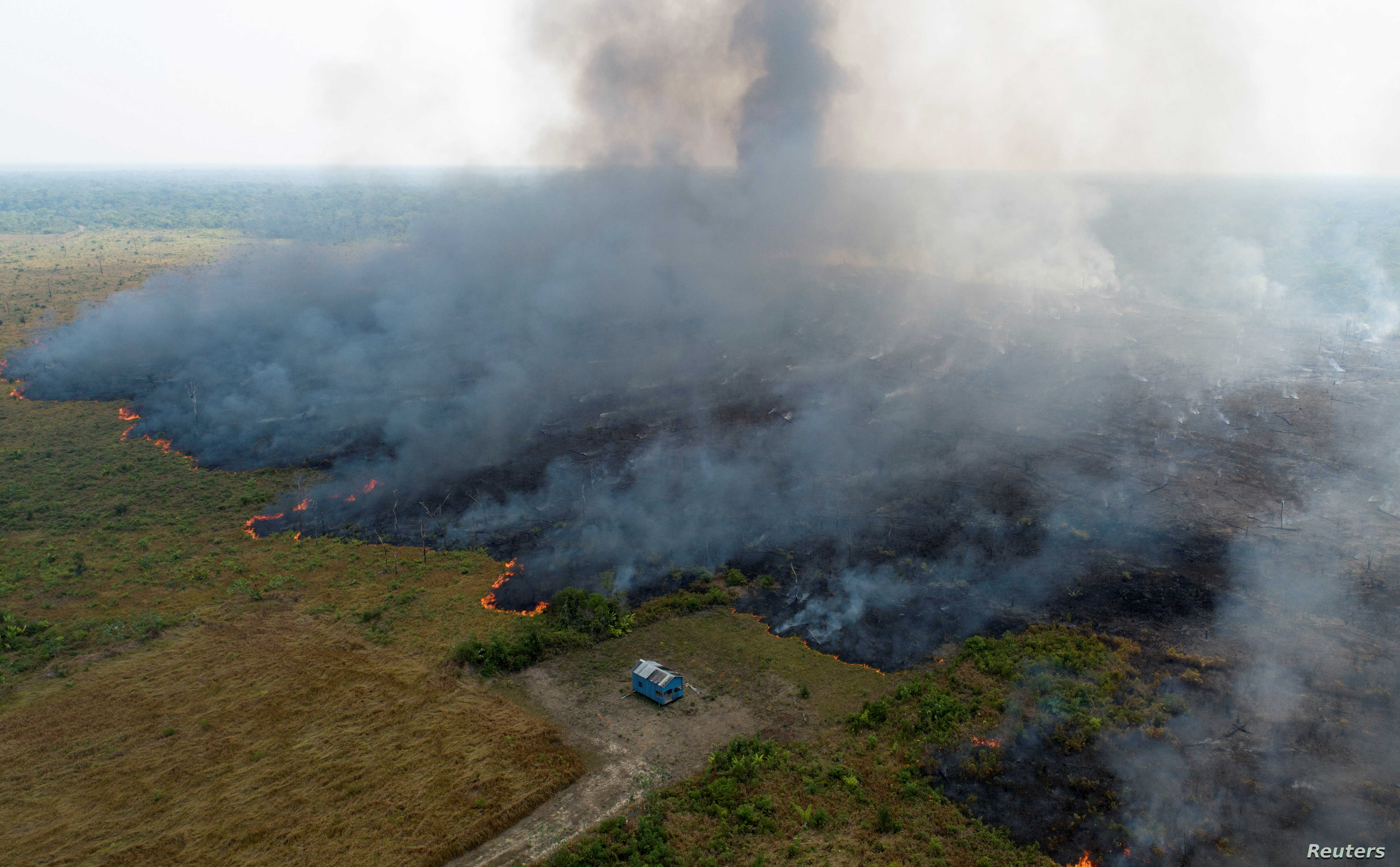 An aerial view shows smoke rising over a deforested plot of the Amazon jungle in Porto Velho, Rondonia State, Brazil, Aug. 27, 2019.