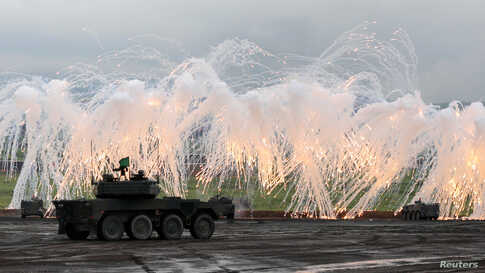Japanese Ground Self-Defense Force tanks and other armored vehicles take part in an annual training session near Mount Fuji at Higashifuji training field in Gotemba, west of Tokyo.
