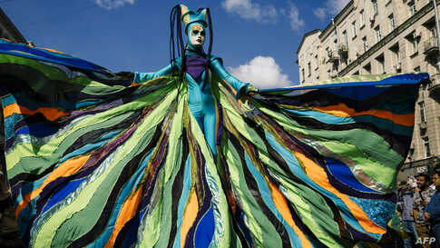 An artist performs on Tverskaya street during celebrations marking the 872nd anniversary of the city of Moscow, Sept. 7, 2019, in Moscow, Russia.