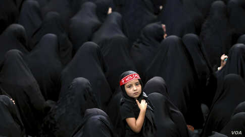 Muslim Shi'ite women attend a mourning ceremony five days ahead of Ashoura, at the Sadat Akhavi Mosque in Tehran, Iran.