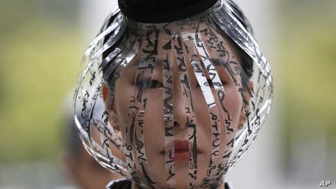 A model displays a creation featuring the Korean alphabet, Hangeul, by one of 40 designers during the Hangeul fashion show as a part of Seoul 365 Fashion Show at the National Hangeul Museum in Seoul, South Korea.