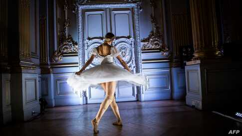 """A dancer of the Paris Opera Ballet performs during the dancing show """"Degas Danse"""" on the sidelines of the exhibition """"Degas at the Opera"""" at the Orsay museum in Paris, France, Oct. 9, 2019."""