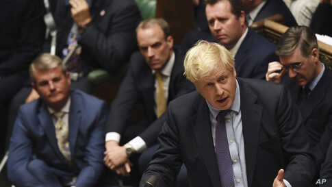 Britain's Prime Minister Boris Johnson speaks in the House of Commons following the debate for the EU Withdrawal Agreement Bill, in London, Oct. 22, 2019.