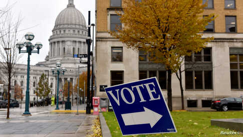 A sign directs voters towards a polling place in Madison, Wisconsin