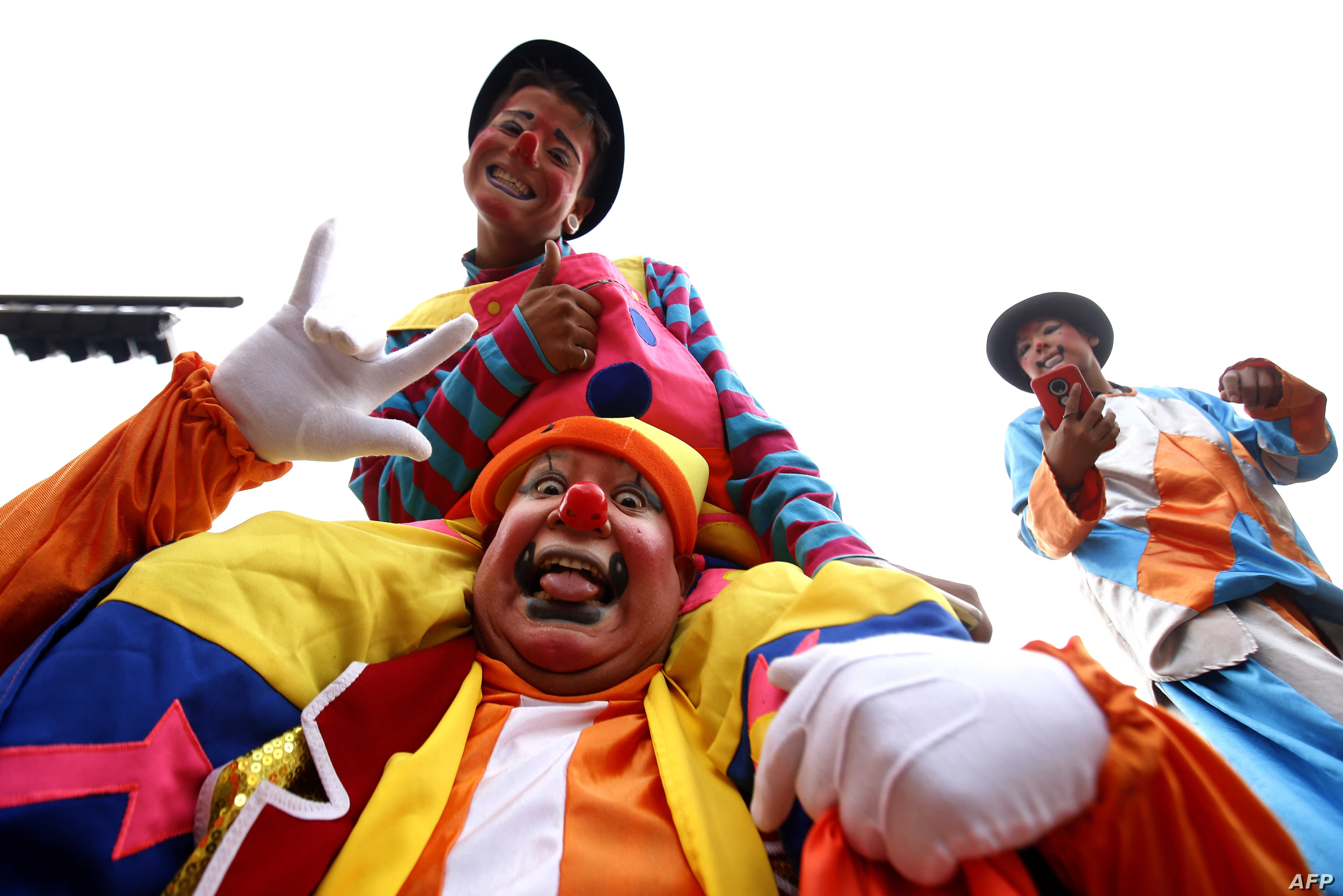 Clowns pose for a picture during the International Clown Day in Guadalajara, Mexico, Dec. 10, 2019.