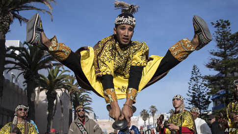 A Gnawa traditional group performs in the city of Essaouira, Dec. 14, 2019, to celebrate the decision of adding the Gnawa culture to UNESCO's list of Intangible Cultural Heritage of Humanity.