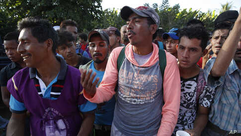 A Honduran migrant stands in line for breakfast at a temporary shelter in Tecun Uman, Guatemala, at the border with Mexico, Jan. 19, 2020.