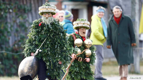 "Men dressed as ""Chlaeuse"", figures that scare away evil spirits, carry round bells and cowbells during the traditional ""Sylvesterchlausen"" in near the northeastern village of Urnaesch, Switzerland."