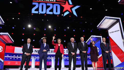 Democratic presidential hopefuls, from left, former New York Mayor Mike Bloomberg, former South Bend, Ind., Mayor Pete Buttigieg, Massachusetts Sen. Elizabeth Warren, Vermont Sen. Bernie Sanders, former Vice President Joe Biden, Minnesota Sen. Amy Klobuchar and billionaire activist Tom Steyer at the Democratic debate, Feb. 25, 2020, in Charleston, S.C.