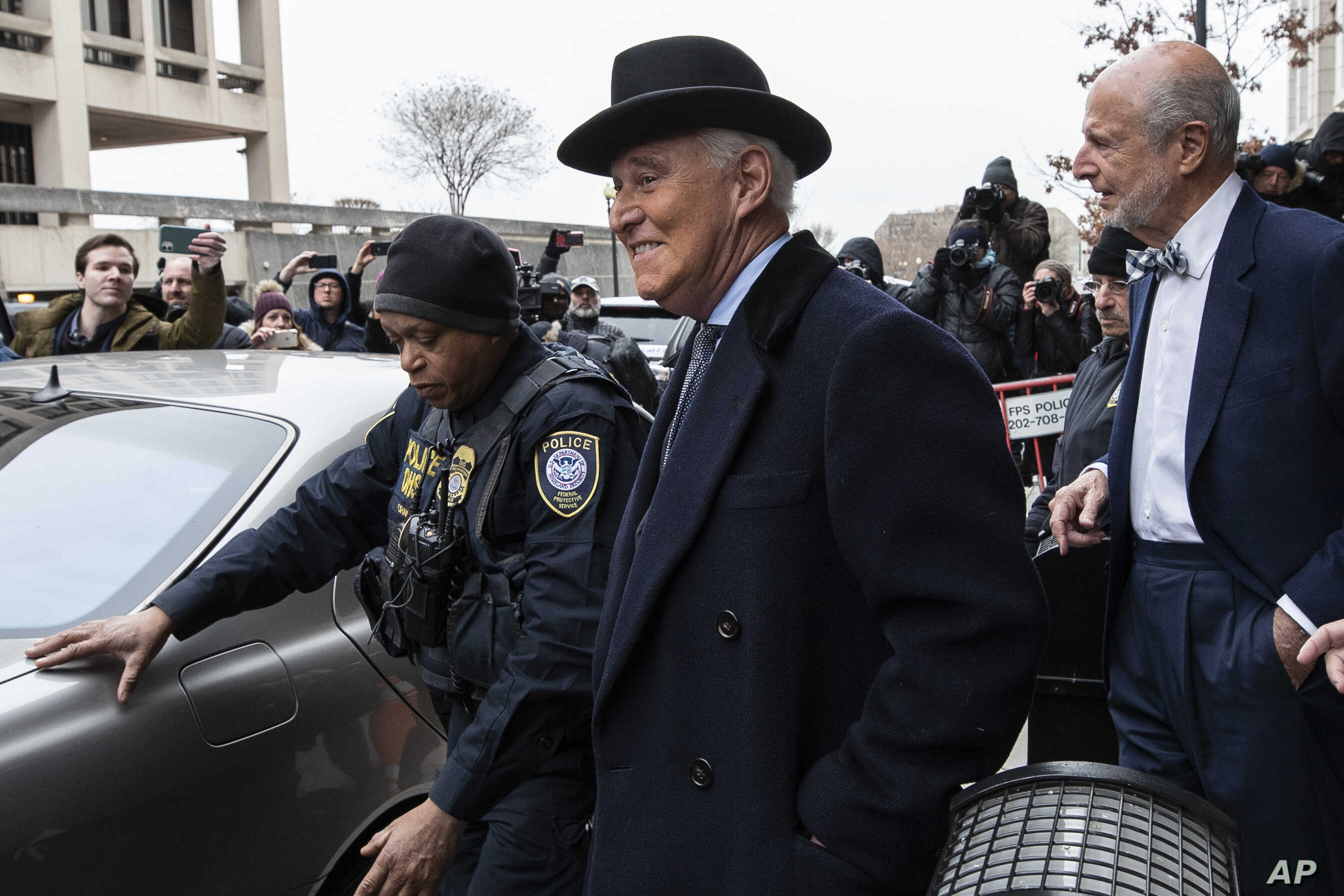 Roger Stone, center, departs federal court in Washington, Thursday, Feb. 20, 2020. President Donald Trump loyalist and ally,…