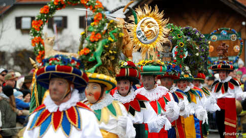 Participants dressed as Schleicher attend the traditional Schleicherlaufen run during Shrovetide (Fasnacht) in Telfs, Austria.