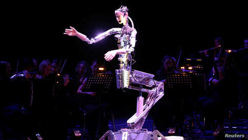 A robot maestro leads an orchestra at the Sharjah Performing Arts Academy in Sharjah, UAE.