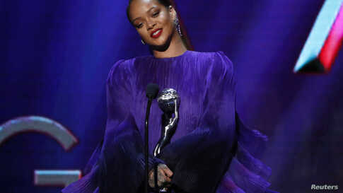 Singer Rihanna holds the President's award trophy onstage at the 51st NAACP Image Awards in Pasadena, California, U.S.