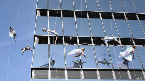 "Vertical performers ""BANDALOOP"" perform at the opening of ""Edge,"" the Western Hemisphere's highest outdoor sky deck in New York City."