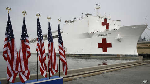 The U.S. Navy hospital ship USNS Comfort is docked at Naval Station Norfolk in Norfolk, Virginia, March 28, 2020. The ship is set to depart for New York to assist hospitals responding to the coronavirus outbreak.