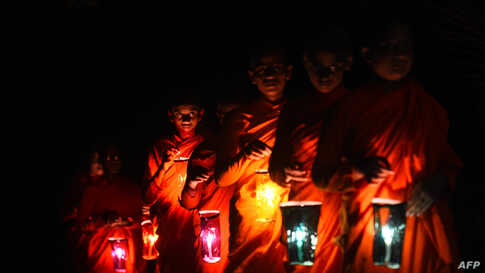 Buddhist nuns light paper lanterns on Vesak day, a festival also known as Buddha Jayanti, to commemorate the birth, enlightenment, and death of Gautama Buddha, at the Dekanduwala Bhikkhuni training center in Horana, Sri Lanka.