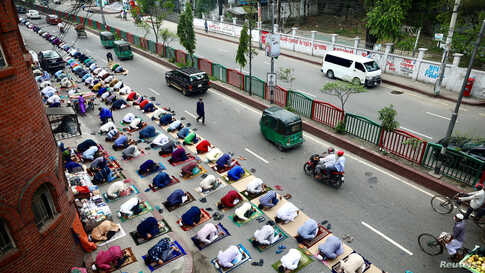 Muslims attend the Friday prayer on the street during the holy month of Ramadan amid concerns over the coronavirus disease …