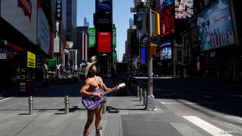 The Naked Cowboy stands alone in Times Square as Broadway theatres extended their closure due the outbreak of the coronavirus…