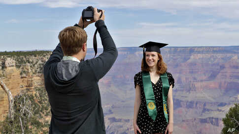 Andrew Fink takes a photo of recent Baylor University graduate Cady Malachowski at the Grand Canyon Friday, May 15, 2020, in…