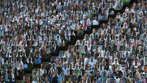 Cardboard cut-outs with portraits of Borussia Moenchegladbach's supporters are seen at the Borussia Park football stadium in Moenchengladbach, western Germany, amid the COVID-19 pandemic.