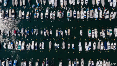 An aerial view shows boats moored in Aberdeen Harbor in Hong Kong.