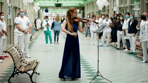 Italian violinist Fiamma Flavia Paolucci performs at Tor Vergata Hospital in Rome, as the world is marking International Nurses Day, during the country's partial lockdown aimed at curbing the spread of the COVID-19.