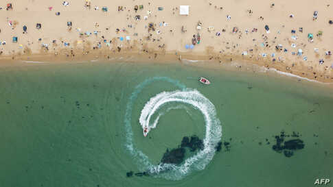 In an aerial photo, holiday-makers visit a beach in Sokcho, on South Korea's north-east coast, May 2, 2020.