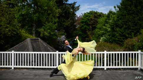 Ballroom dancers Roman Sukhomlyn and India Phillips, the North of England Champions at the British National Dance Championships, practice on their balcony at home in Wolverhampton, central England.