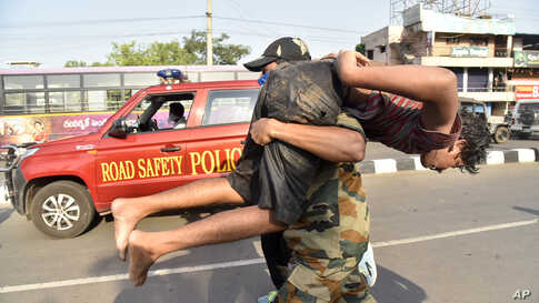 A boy affected by a chemical gas leak is carried for medical treatment in Vishakhapatnam, India.