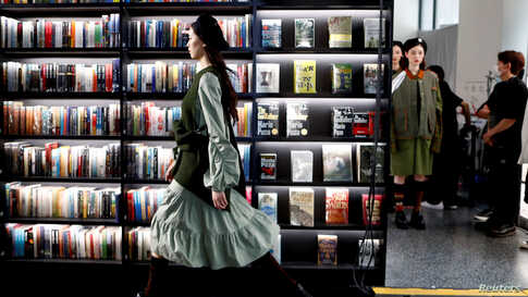 Models present creations during a livestreamed Autumn/Winter 2020 collection show held inside a bookstore with no audience during China Fashion Week in Beijing, China, May 6, 2020.