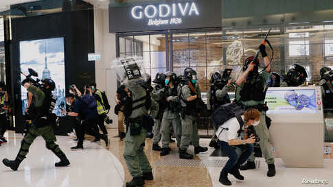 Riot police disperse anti-government protesters during a rally in a shopping mall in Hong Kong, China.
