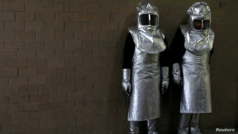Workers using protective gear are seen at a crematorium in Nezahualcoyotl during the outbreak of the coronavirus disease (COVID-19), on the outskirts of Mexico City, Mexico, May 16, 2020.