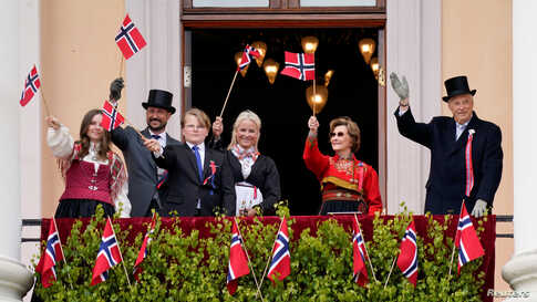Norway's Queen Sonja and King Harald, Crown Prince Haakon, Crown Princess Mette-Mari, Princess Ingrid Alexandra and Prince Sverre Magnu waves Norwegian flags, during the Norwegian Constitution Day, in Oslo.