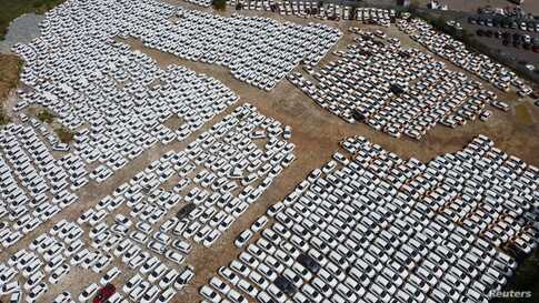 Car sharing vehicles are seen at a parking lot amid the COVID-19 outbreak, on the outskirts of Moscow, Russia, May 20, 2020.