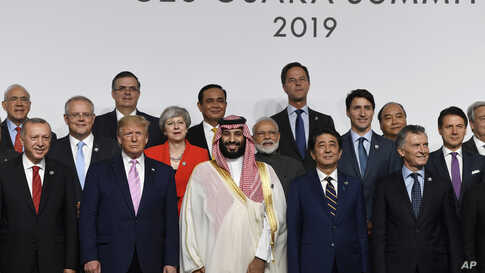 President Donald Trump, fifth from left, joins other leaders for a group photo at the G-20 summit in Osaka, Japan, Friday, June 28, 2019. (AP Photo/Susan Walsh)