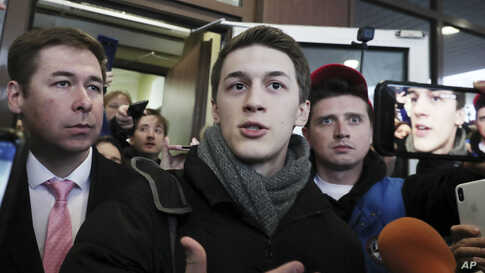 Moscow student Yegor Zhukov speaks to the media after his trial in Moscow, Russia, Friday, Dec. 6, 2019. The court on Friday…