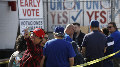 People wait in line to vote early at the Culinary Workers union Monday, Feb. 17, 2020, in Las Vegas. Nevada's first-in-the West…
