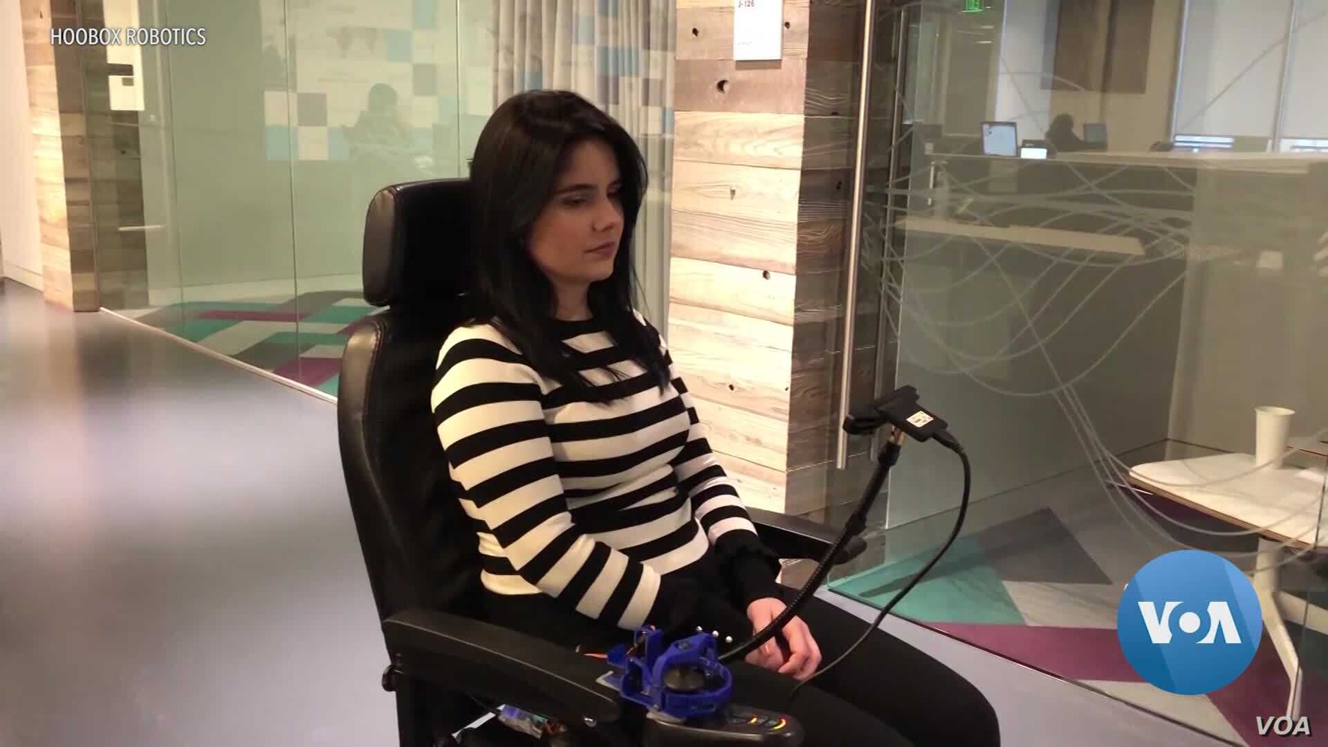 A Wheelchair that Moves with a Kiss, a Smile or Raised Eyebrows