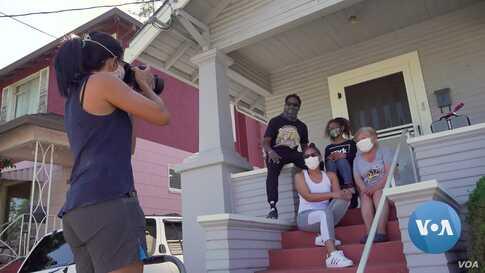 Capturing the Moment: Photographers Fan Out to Portray Families Sheltering at Home