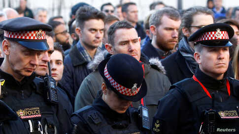 Police officers attend a vigil for victims of a fatal attack on London Bridge in London, Britain December 2, 2019.  REUTERS…