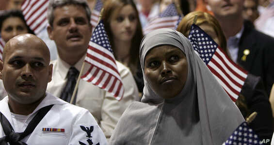 Sahro Farah, right, and about 350 other new United States citizens from the Phoenix area participate in the 18th Annual Fiesta