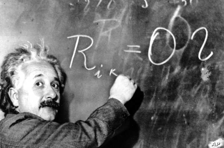 FILE - Dr. Albert Einstein writes out an equation for the density of the Milky Way on the blackboard at the Carnegie Institute, Mt. Wilson Observatory headquarters in Pasadena, Calif., Jan. 14, 1931