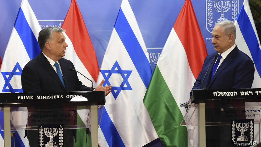 Hungarian Prime Minister Viktor Orban, left, speaks during a joint press conference with Israeli Prime Minister Benjamin Netanyahu, at the Prime Minister's office in Jerusalem, July 19, 2018.