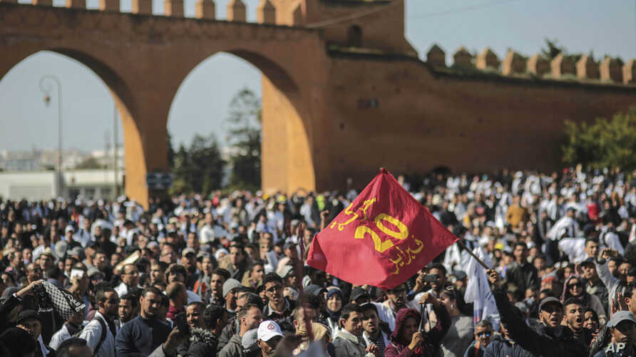 Protesters wave a flag commemorating the Feb. 20 Moroccan Arab Spring movement, during a demonstration in Rabat, Morocco, Feb. 20, 2019.