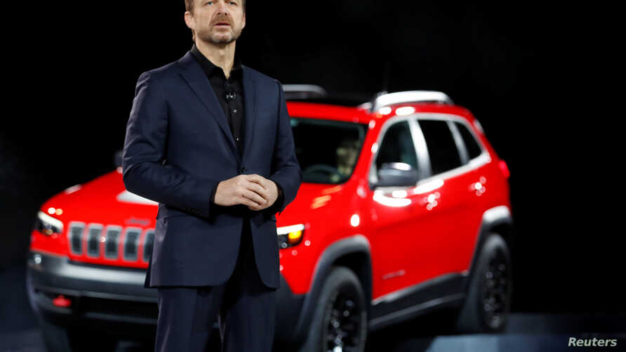 FILE -  Mike Manley introduces the 2019 Jeep Cherokee at the North American International Auto Show in Detroit, Jan. 16, 2018. Manley on July 21, 2018, was named chief executive of Fiat Chrysler Automobiles.