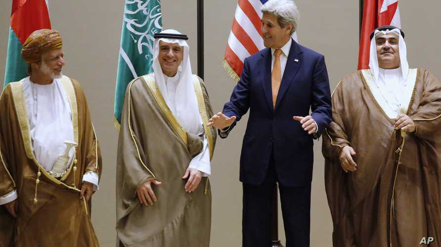 From left, Oman Foreign Minister Yusuf bin Alawi, Saudi Arabia Foreign Minister Adel al-Jubeir, Secretary of State John Kerry and Bahrain Foreign Minister Khalid bin Ahmed Al Khalifa, stand together for a family photo at the start of the Gulf Coopera