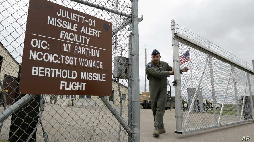 FILE - A gate is closed at an ICBM launch control facility in the countryside outside Minot, North Dakota, on the Minot Air Force Base, June 24, 2014.