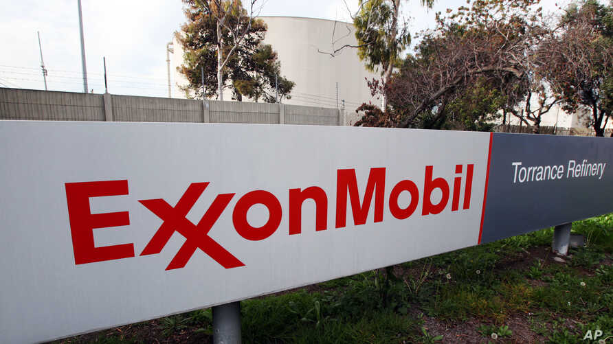 FILE - The sign for the Exxon Mobil Torrance Refinery in Torrance, Calif., Jan. 30, 2012. An explosion and fire at an oil refinery in Torrance, California, on Saturday forced the partial shutdown of the plant, leading oil traders to expect a spike th